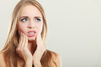 Toothache. Woman suffering from tooth pain